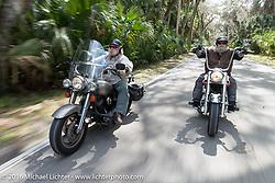 Biker Jimmy (L) and WIllie Jones of Tropical Tattoo riding through Tomoka State Park during Daytona Bike Week 75th Anniversary event. FL, USA. Thursday March 3, 2016.  Photography ©2016 Michael Lichter.