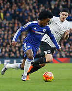 Chelsea attacker Willian on the ball during the Barclays Premier League match between Chelsea and Everton at Stamford Bridge, London, England on 16 January 2016. Photo by Andy Walter.