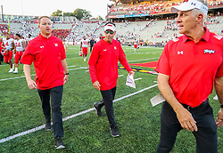 Sep 4, 2021; College Park, Maryland, USA; Maryland Terrapins offensive coordinator Dan Enos (center) celebrates with coaches after defeating the West Virginia Mountaineers at Capital One Field at Maryland Stadium. Mandatory Credit: Ben Queen-USA TODAY Sports