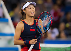 September 26, 2018 - Qiang Wang of China celebrates winning her third-round match at the 2018 Dongfeng Motor Wuhan Open WTA Premier 5 tennis tournament (Credit Image: © AFP7 via ZUMA Wire)