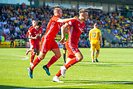 Andy Considine (#4) of Aberdeen FC celebrates with Niall McGinn (#10) of Aberdeen FC after scoring the opening goal during the Ladbrokes Scottish Premiership match between Livingston FC and Aberdeen FC at The Tony Macaroni Arena, Livingston, Scotland on 21 September 2019.