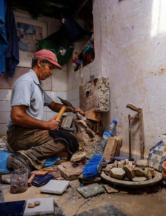 RABAT, MOROCCO - CIRCA APRIL 2017: Mosaic worker at the Kasbah Oudayas in Rabat