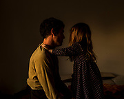 My daughter grabs my husband's shoulder in our sleeping room in Buenos Aires, Argentina on June 2, 2020. Lockdown has brought us closer together, a sudden break in our everyday rushing life.