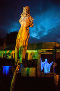"""A scarecrow looms over Chris Baker's haunted yard (image from last year's display) in South Yarmouth, MA. Every year Baker sets up an elaborate Halloween display in his yard and on Halloween, neighborohood residents walk through his frightening """"vortex"""" of horror while trick or treating."""