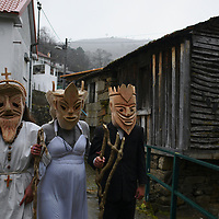 The traditional Entrudo (Carnival) of Lazarim, where on Tuesday people in wood masks gather in village's main square.