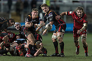 Tavis Knoyle of the Newport Gwent Dragons passes the ball out as Ben Toolis of Edinburgh (r) charges forward and Lewis Evans of the Newport Gwent Dragons (2nd right)  looks on. Guinness Pro12 rugby match, Newport Gwent Dragons  v Edinburgh rugby at Rodney Parade in Newport, South Wales on Sunday 27th November 2016.<br /> pic by Simon Latham, Andrew Orchard sports photography.
