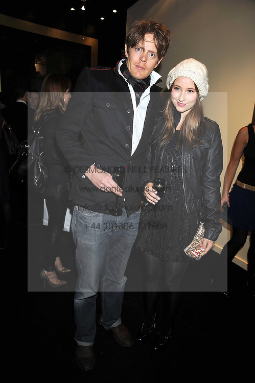 KRIS MARSHALL and KELLY EASTWOOD at the opening of the Atelier Moet pop-up boutique, 70 New Bond Street, London on 3rd December 2008.