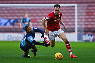 Curtis Thompson of Wycombe Wanderers (18) fails to bring down Cauley Woodrow of Barnsley (9) during the EFL Sky Bet League 1 match between Barnsley and Wycombe Wanderers at Oakwell, Barnsley, England on 16 February 2019.