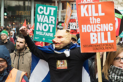 """London, April 16th 2016. A man wears a rubber pig mask as thousands of people supported by trade unions and other rights organisations demonstrate against the policies of the Tory government, including austerity and perceived favouring of """"the rich"""" over """"the poor""""."""