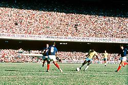 Pele of Brazil (right) shoots for goal