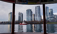 View of Yaletown and downtown Vancouver from the False Creek Ferry, on a late winter afternoon in British Columbia