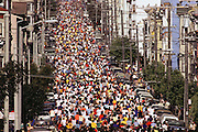 Bay to Breakers annual race. Runners climb the Hayes St. hill. San Francisco, California.