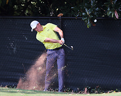 September 21, 2017 - Atlanta, GA, USA - Jordan Spieth hits his second shot from beside the fence off the 1st fairway in the opening round of the Tour Championship on Thursday, Sept. 21, 2017, at Eastlake Golf Club in Atlanta. (Credit Image: © Curtis Compton/TNS via ZUMA Wire)