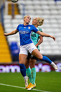 Birmingham City forward  Libby Smith (12) heads the ball during the FA Women's Super League match between Birmingham City Women and Brighton and Hove Albion Women at St Andrews, Birmingham United Kingdom on 12 September 2021.