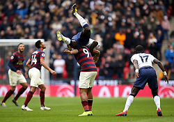 Tottenham Hotspur's Davinson Sanchez lands on Newcastle United's Salomon Rondon as he jumps for the ball during the Premier League match at Wembley Stadium, London.