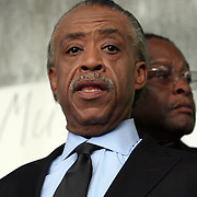 Reverend Al Sharpton stands on stage during a rally for the shooting of Trayvon Martin on Thursday, March 22, 2012 at Fort Mellon Park in Sanford, Florida. (AP Photo/Alex Menendez) Trayvon Martin rally in Sanford, Florida.