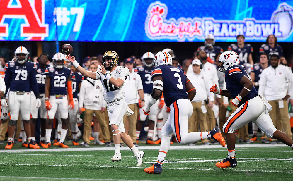 UCF Knights quarterback McKenzie Milton (10) throws against Auburn University during the second half of the Chick-fil-A Peach Bowl NCAA college football game at the Mercedes-Benz Stadium in Atlanta, January 1, 2018. UCF won 34-27 to go undefeated for the season. (David Tulis via Abell Images for Chick-fil-A Peach Bowl)