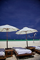 Sun lounges and umbrellas on the beachfront of White Sand Beach, Boracay, Philippines.