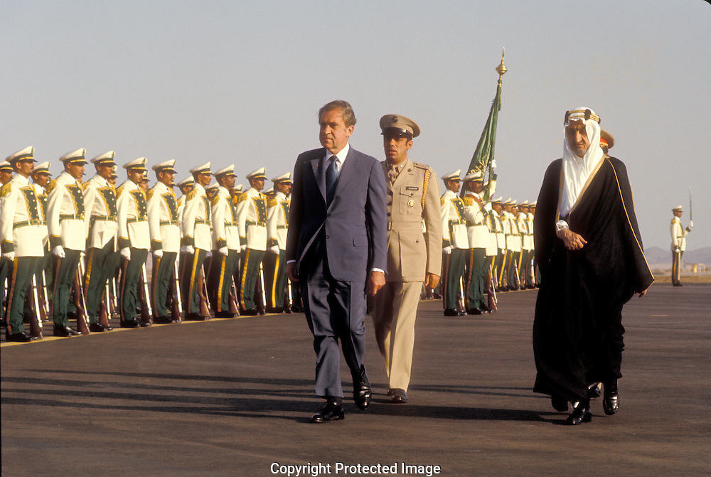 .President Richard Nixon reviews troops with King Faisel in Saudi Arabia during President Nixon's trip to the Middle East in July 1974.Photograph by Dennis Brack  BS B16