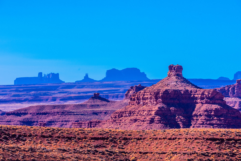 Rock formations of the Valley of the Gods with the Monument Valley in the background, Utah USA.