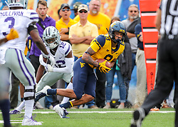 Sep 22, 2018; Morgantown, WV, USA; West Virginia Mountaineers wide receiver Marcus Simms (8) catches a pass and runs during the first quarter against the Kansas State Wildcats at Mountaineer Field at Milan Puskar Stadium. Mandatory Credit: Ben Queen-USA TODAY Sports