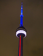November 14, 2015 - Toronto, Canada - <br /> <br /> Colors that resemble the French national flag are seen on the Canadian National Tower in Toronto, Nov. 13, 2015. Over 100 people were killed in a mass hostage-taking at a Paris concert hall Friday and many more were feared dead in a series of bombings and shootings. ©Exclusivepix Media
