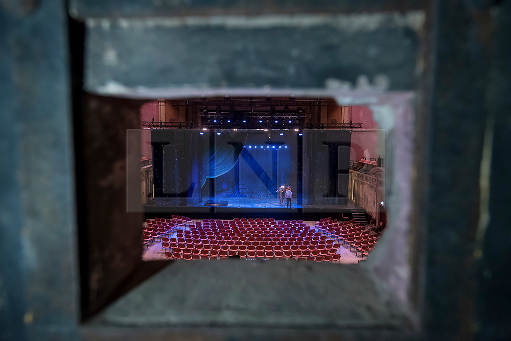 © Licensed to London News Pictures. 30/11/2018. LONDON, UK. A view of the stage through the projection booth window.   Alexandra Palace Theatre re-opens to the public for the first time in 80 years following a £27 million restoration, supported by the Heritage Lottery Fund and Haringey Council.  Originally opened in 1875, Alexandra Palace Theatre was where audiences were entertained by pantomime, opera, drama, ballet and music hall.  The Victorian engineering marvel re-opens in December 2018 with a programme of drama, music, comedy and family shows.  Photo credit: Stephen Chung/LNP