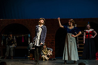 """Kathryn Osburn as Oliver with Chelsea Sasserson at Bet during dress rehearsal for Gilford High School's musical production of """"Oliver"""" on Tuesday evening.  (Karen Bobotas/for the Laconia Daily Sun)"""