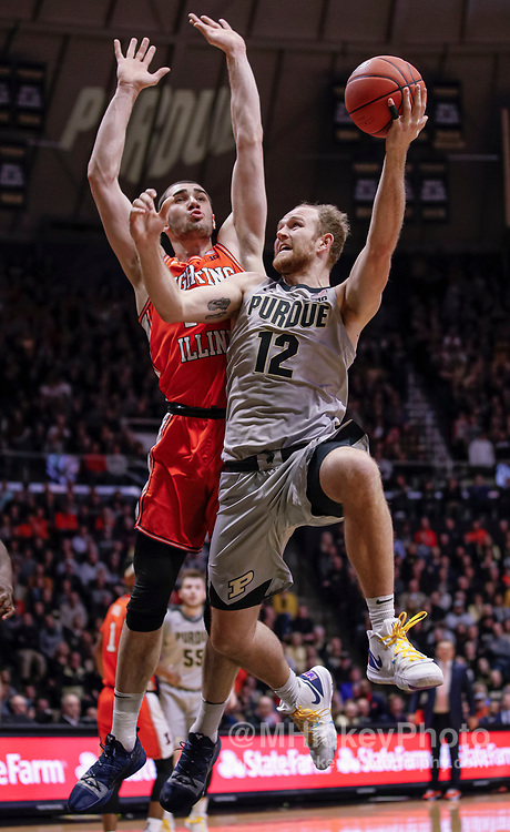 WEST LAFAYETTE, IN - JANUARY 21: Evan Boudreaux #12 of the Purdue Boilermakers shoots the ball against Giorgi Bezhanishvili #15 of the Illinois Fighting Illini at Mackey Arena on January 21, 2020 in West Lafayette, Indiana. (Photo by Michael Hickey/Getty Images) *** Local Caption *** Evan Boudreaux; Giorgi Bezhanishvili