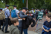 On the 100th anniversary of the Royal Air Force (RAF) and following a flypast of 100 aircraft formations representing Britain's air defence history which flew over central London, a serviceman kisses a lady, 10th July 2018, in London, England.