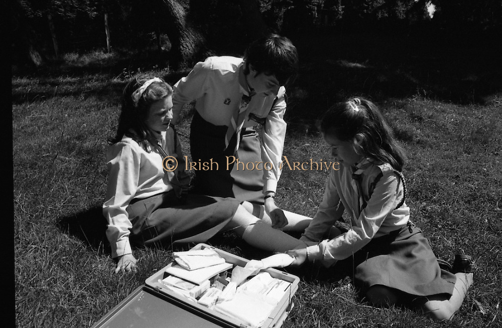 300 Girl Guides At Larch Hill.  (R84)..1988..25.07.1988..07.25.1988..25th July 1988..As part of the Diamond Jubilee celebrations the girl guide movement organised a friendship camp for 300 girls.The friendship camp was set up in the grounds of Larch Hill, Tibradden,Co Dublin. The camp will run from 23rd July to 30th July...Image shows the guides being taught the fundamentals of first aid while they are on the camp site.