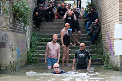 © Licensed to London News Pictures. 31/08/2018. London, UK.  Participants prepare to take part in the Tidal River Swim in Hammersmith this evening, launching this years Thames Festival. Over 100 brave enthusiasts took part in a 30 minute swim, as they followed the tide towards Chiswich Eycot and back. Photo credit: Vickie Flores/LNP