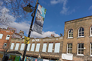 Construction and regeneration hoardings featuring local arts and community on 7th March 2017, on Station Square, Railton Road in Herne Hill, SE24, London borough of Lambeth, England.