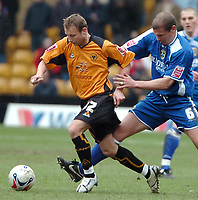 Photo: Ed Godden.<br />Wolverhampton Wanderers v Cardiff City. Coca Cola Championship. 11/03/2006. <br />Wolves' Tomasz Frankowski (L) is challenged by Cardiff's Neil Cox.