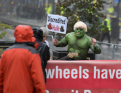 Pictured: Protester dressed as Boris as the Incredible Hulk joined the demonstration outside the conference venue.<br /> <br /> protesters demonstrated on the first day of the Conservative Party conference in Manchester.<br /> <br /> © Dave Johnston / EEm