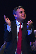 © Licensed to London News Pictures. 03/10/2012. Manchester, UK Ed Balls, Shadow Chancellor, applauds his wife, Shadow Home Secretary Yvette Cooper after she dlivers her speech to conference on Day 4 at The Labour Party Conference at Manchester Central today 3rd october 2012. Photo credit : Stephen Simpson/LNP