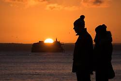 © Licensed to London News Pictures. 02/01/2017. Southsea, UK.  People enjoying the last of the bank holiday sunshine during sunset on Southsea promenade this evening, 2nd January 2017. Photo credit: Rob Arnold/LNP