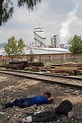 "Central american migrants take a rest in the train tracks in Lechería after the migrants shelter  ""San Juan Diego Cuauhtlatoatzin"" was closed in Lecheria, Estado de México on July 9th, 2012. (Photo: Prometeo Lucero)"