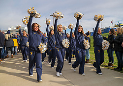 Nov 9, 2019; Morgantown, WV, USA; West Virginia Mountaineers cheerleaders lead the team into the stadium before their game against the Texas Tech Red Raiders at Mountaineer Field at Milan Puskar Stadium. Mandatory Credit: Ben Queen-USA TODAY Sports