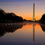 Reflections of the Washington Monument, US Capitol and the morning dawn are seen in the reflecting pool in Washington, DC