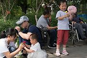 Generations play on weekend in Beijing Gulou park