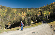 Woman hiker on trail above Taos Ski Valley<br />
