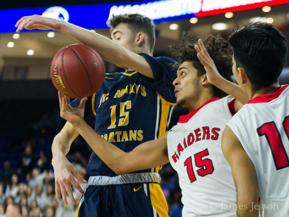 Watertown High School junior Yoseph Hamad tries to grab a loose ball from Saint Mary's sophomore Joseph Abate-Walsh during the MIAA Division 3 North sectional final at the Tsongas Center in Lowell, March 10, 2018. Watertown won the game, 44-36.   [Wicked Local Photo/James Jesson]