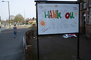 Local response to Coronavirus is felt on a street by street level as a thank you message to NHS staff is written on a board outside a pub on 9th April 2020 in Birmingham, England, United Kingdom. Coronavirus or Covid-19 is a new respiratory illness that has not previously been seen in humans. While much or Europe has been placed into lockdown, the UK government has announced more stringent rules as part of their long term strategy, and in particular social distancing.