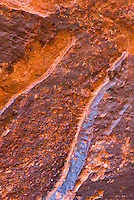 Desert varnish on sandstone walls of Neon Canyon, Grand Staircase Escalante National Monument Utah