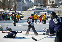 Laurie Marsh makes a passing shot away from the Quincy Fighting Squirrel's goal during the womens division pool play on Saturday at New England Pond Hockey.  (Karen Bobotas/for the Laconia Daily Sun)