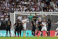 Goalkeeper Danijel Subasic of AS Monaco punches the ball clear from a corner. UEFA Champions league match, group E, Tottenham Hotspur v AS Monaco at Wembley Stadium in London on Wednesday 14th September 2016.<br /> pic by John Patrick Fletcher, Andrew Orchard sports photography.