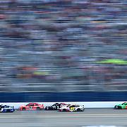 Sprint Cup Series driver Denny Hamlin (11) leads the pack down the backstretch during the 57th Annual NASCAR Daytona 500 race at Daytona International Speedway on Sunday, February 22, 2015 in Daytona Beach, Florida.  (AP Photo/Alex Menendez)