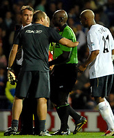 Photo: Ed Godden.<br /> Portsmouth v Bolton Wanderers. The Barclays Premiership. 25/09/2006. Bolton's El-Hadji Diouf (R) confronts the Referee, Uriah Rennie at the end of the first half.
