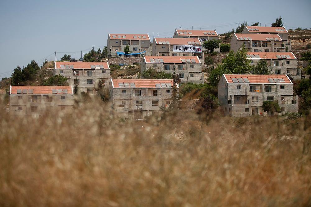 A general view of the Ulpana neighborhood in the West Bank Jewish settlement of Beit El, near the Palestinian West Bank city of Ramallah, on June 11, 2012. The Israeli government plans to evacuate and relocate five houses at the Ulpana neighborhood in the West Bank settlement of Beit El, after the Israeli Supreme Court ruled that the houses were illegaly built on land classified as private Palestinian property, and must be evacuated and demolished by July 1.